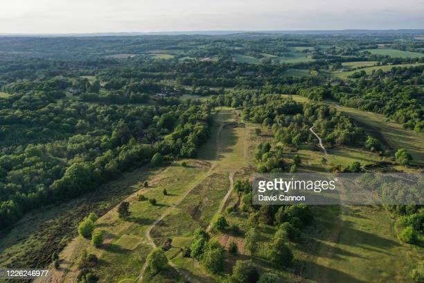 An aerial view of the par 5, 12th hole at Royal Ashdown Forest Golf Club. The British government has started easing the lockdown it imposed two...