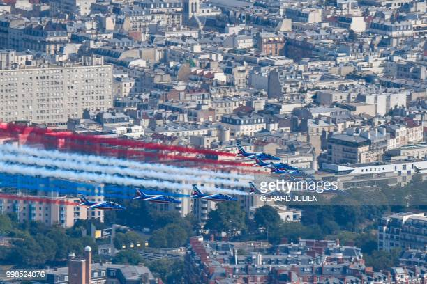 An aerial view of the Patrouille de France Alpha Jet aircrafts flying over the city during the annual Bastille Day military parade on the...