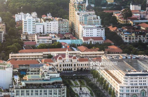 an aerial view of the people's committee building in ho chi minh city in vietnam - didier marti stock photos and pictures