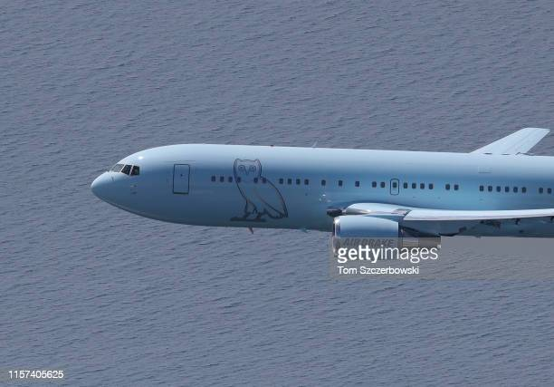 An aerial view of the private plane belonging to Drake with the OVO insignia on the exterior lands at the island airport as fans turn out for the...