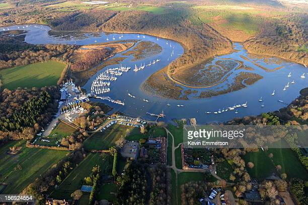 An aerial view of the River Beaulieu as it meanders past Bucklers Hard in Hampshire, England.