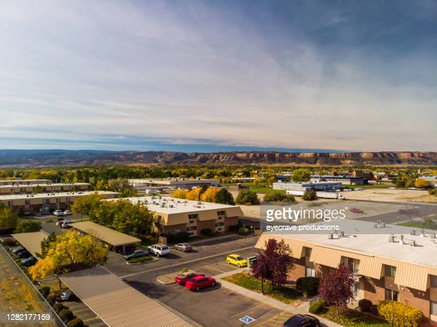 an aerial view of the rooftops of apartments in an older established subdivision in the early morning photo series - eyecrave  stock pictures, royalty-free photos & images