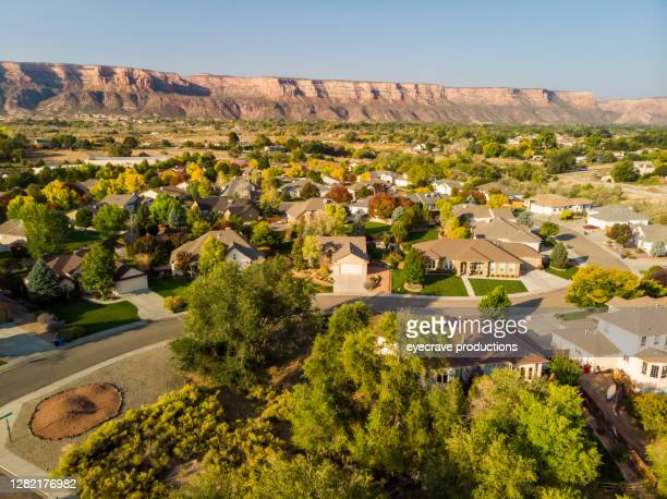 an aerial view of the rooftops of houses in a newer established subdivision in the early morning photo series - golden hour stock pictures, royalty-free photos & images