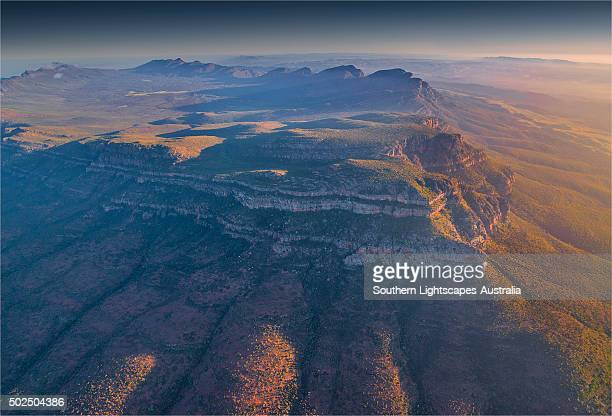 An aerial view of the rugged and scenically beautiful mountain ranges of Wilpena Pound in the southern region of the Flinders Ranges National Park in South Australia.