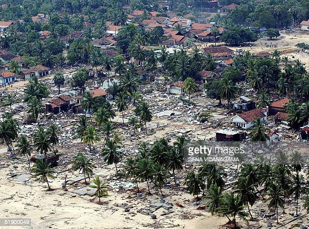 An aerial view of the ruins after hundreds of houses were destroyed by tsunamic waves at Arumgam Bay located in Sri Lanka's eastern district of...