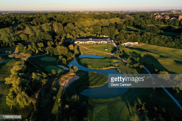 An aerial view of the 'S' shaped lake on the part 4, 18th hole with the clubhouse behind on the Severiano Ballesteros designed Masters Course at The...