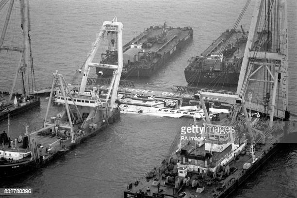 An aerial view of the salvage operation underway on the wreck of the car ferry Herald of Free Enterprise which lies half submerged near the Belgian...