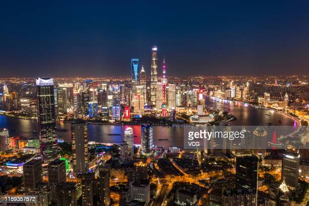 An aerial view of the Shanghai skyline at night on May 28 2019 in Shanghai China