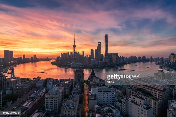 An aerial view of the Shanghai skyline at sunrise on August 12 2019 in Shanghai China