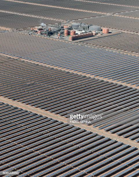 An aerial view of the solar mirrors at the Noor 1 Concentrated Solar Power plant some 20km outside the central Moroccan town of Ouarzazate on...