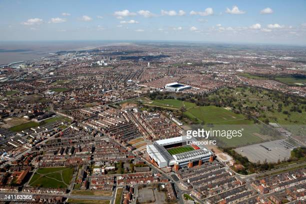 An aerial view of the Stadiums of Liverpool FC and Everton FC, Anfield and Goodison Park, seperated by Stanley Park and Anfield cemetery with the...