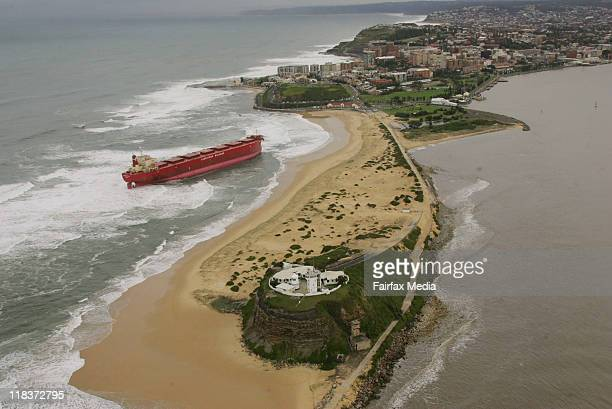 An aerial view of the stranded cargo ship MV Pasha Bulker, which ran aground at the Cowrie Hole, near Nobbys Beach, a popular inner-city beach in...