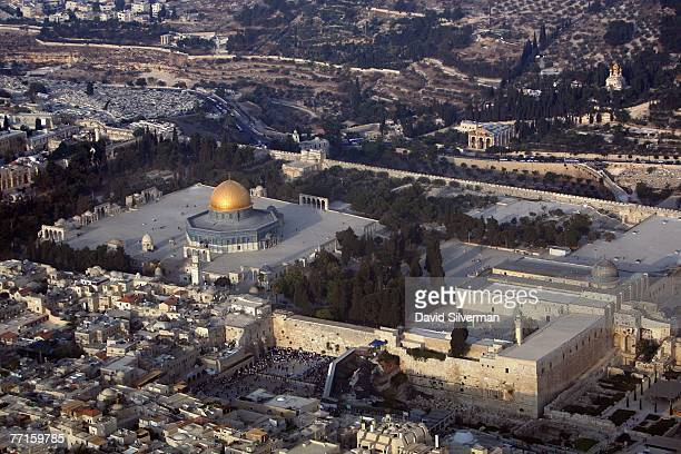 An aerial view of the Temple Mount known to Muslims as elHarem alSharif with it's golden Dome of the Rock Islamic shrine and leaddomed alAqsa mosque...