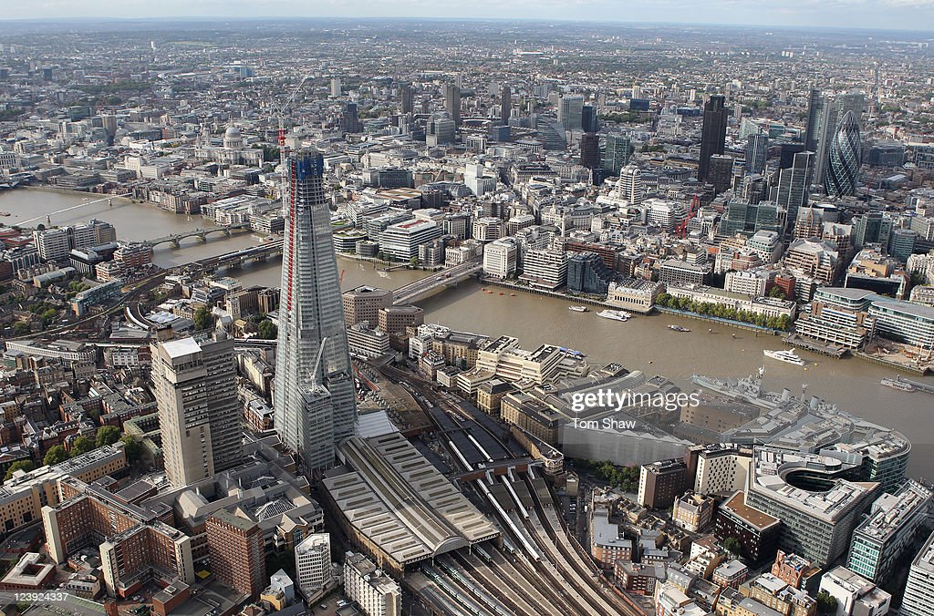 An aerial view of the Thames river in London from the air with The Shard in the foreground on September 5, 2011 in London, England.