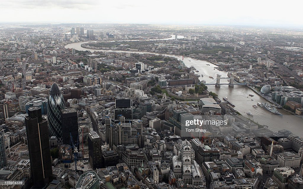 An aerial view of the Thames river in London from the air with The Gherkin in the foreground on September 5, 2011 in London, England.