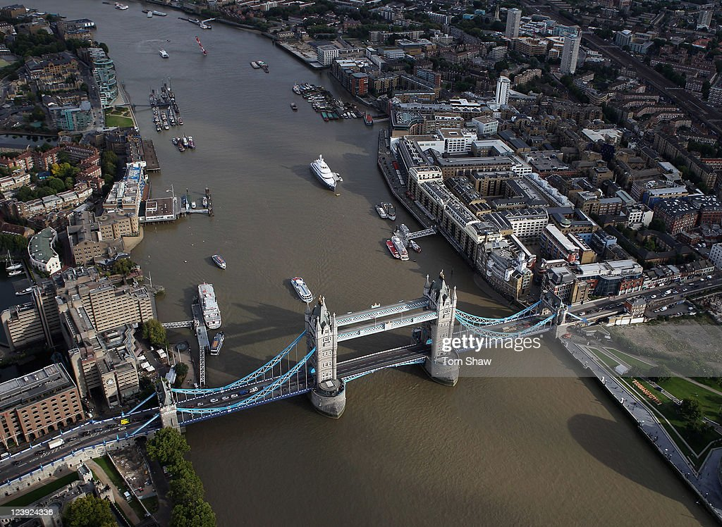 An aerial view of the Thames river in London from the air with Tower Bridge in the foreground on September 5, 2011 in London, England.