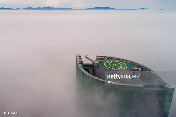 An aerial view of the top of a skyscraper in the heavy fog on January 16 2018 in Ningbo Zhejiang Province of China