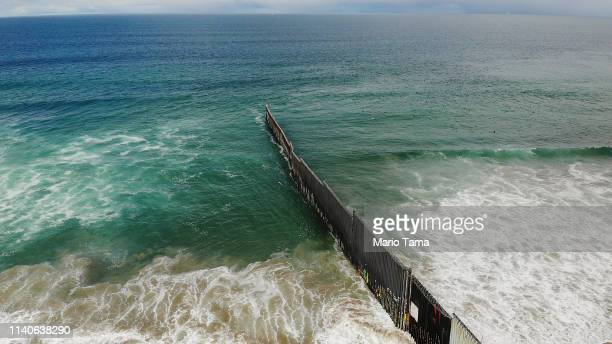 An aerial view of the USMexico border at the beach and Pacific Ocean on April 5 2019 as taken from Tijuana Mexico US President Donald Trump said...
