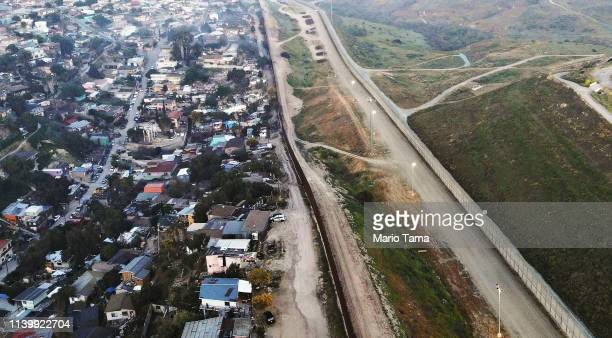 "An aerial view of the USMexico border barrier on April 2 2019 in Tijuana Mexico US President Donald Trump told reporters last week ""there's a very..."