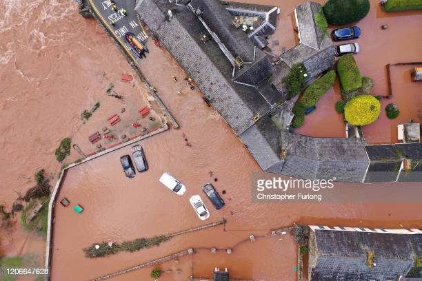An aerial view of the Welsh village of Crickhowell which has been cut off as the river Usk bursts its banks at Crickhowell bridge near the Bridge End...