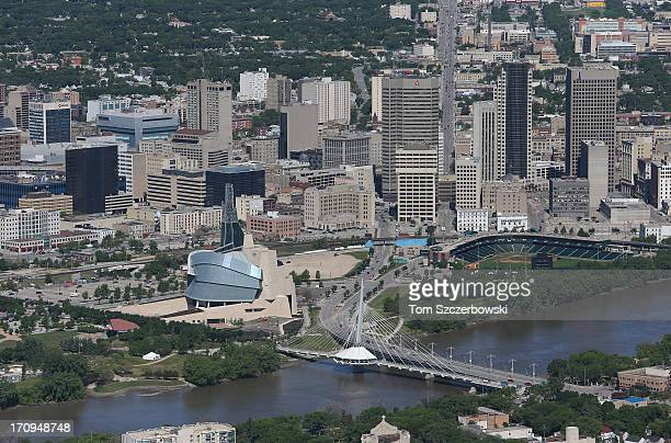 An aerial view of the Winnipeg skyline is seen from above looking north up Main Street with the Red River and Shaw Park home of the Winnipeg Goldeyes...
