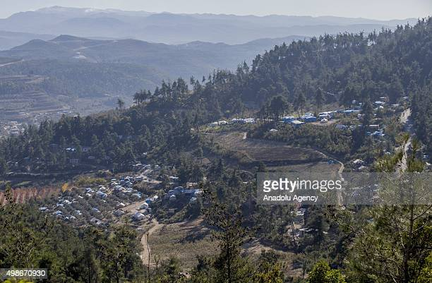An aerial view of the Yamadi camp, as Assad regime forces continue its air attacks on Turkmen town of Bayirbucak in Lattakia, Syria on November 25,...
