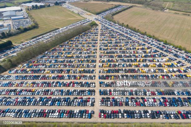 An aerial view of thousands of new and used cars stored at Chipping Warden aerodrome on April 8, 2020 in Chipping Warden,England. Airfields have...