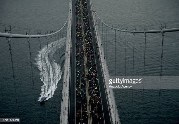An aerial view of thousands of participants competing during Vodafone 39th Istanbul Marathon at The 15 July Martyrs Bridge in Istanbul Turkey on...
