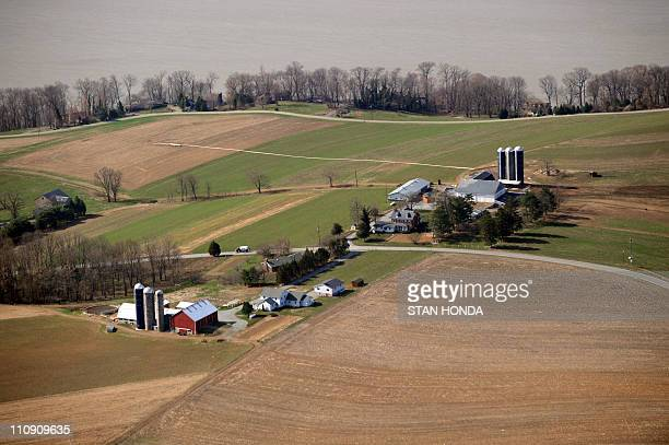 An aerial view of two farms on the Susquehanna River March 25 2011 in Lancaster County Pennsylvania AFP PHOTO/Stan HONDA