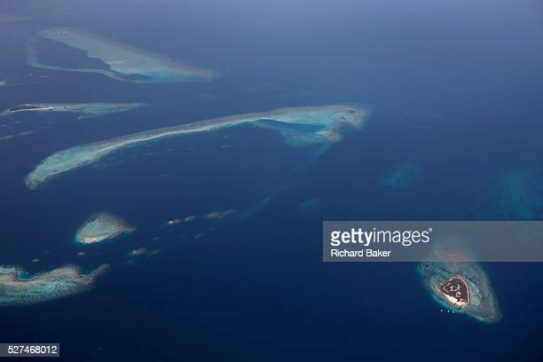 An aerial view of unidentified islands seen from a regional aircraft passing overhead the atolls and islands to the north Mal' capital of the Indian...