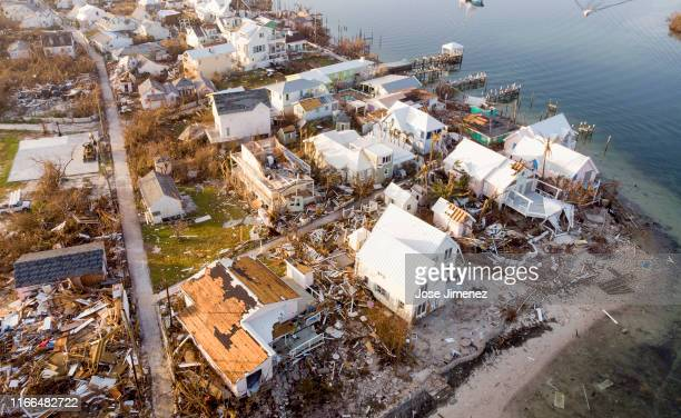 An aerial view of view of damaged homes in Hurricane Dorian devastated Elbow Key Island on September 7 2019 in Elbow Key Island Bahamas The official...