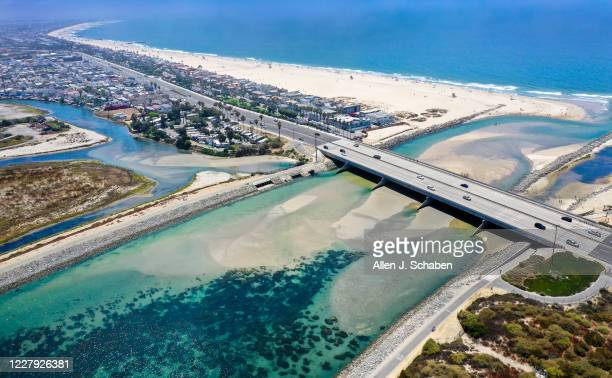 An aerial view of where the Santa Ana River meets the Pacific Ocean Thursday, July 30, 2020 in Newport Beach, CA. The Santa Ana river mouth is one...