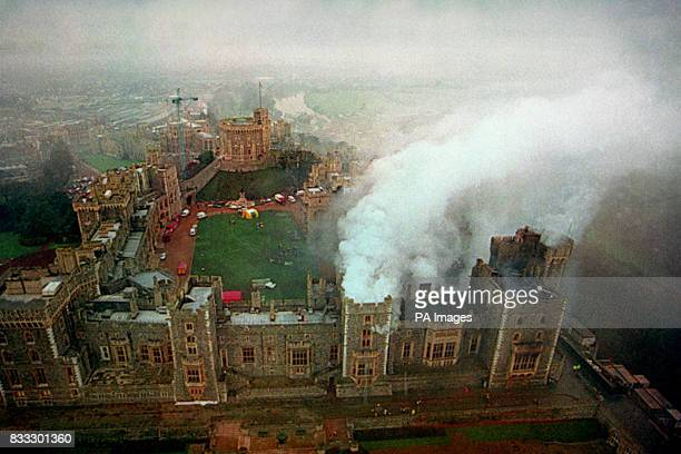 An aerial view of Windsor Castle still smouldering after the fire