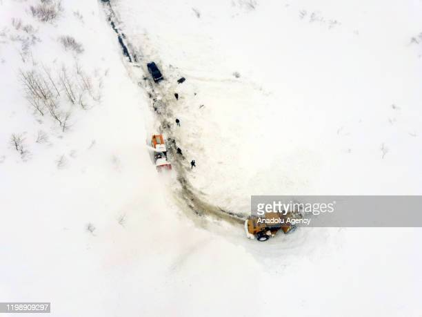 An aerial view of workers using heavy machines to clear huge masses of snow from the streets in Turkey's eastern Mus province on February 06 2020...