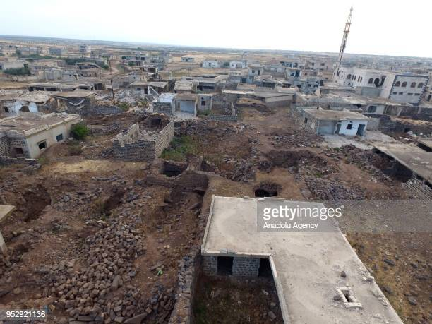 An aerial view of wreckages of structures after the airstrikes over Hola area in northern Homs in Syria on April 30 2018 Assad regime intensified its...