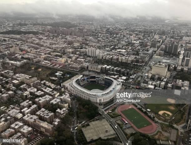 An aerial view of Yankee Stadium in the Bronx is seen through the window of an airplane in New York on October 9 2017 / AFP PHOTO / Daniel SLIM