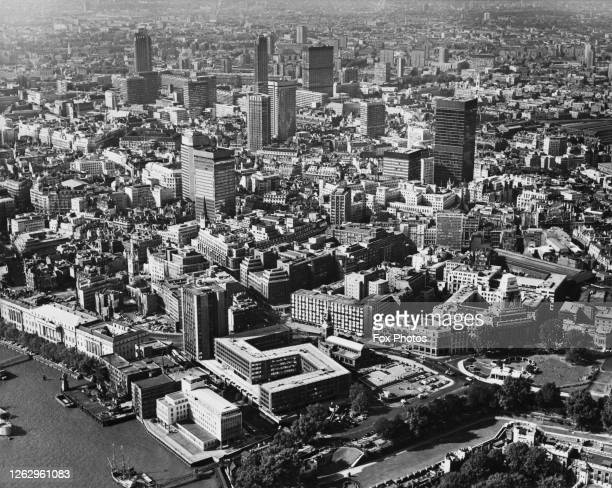 An aerial view over the City of London with the River Thames in the bottom left and Tower Hill in the bottom right 30th December 1971