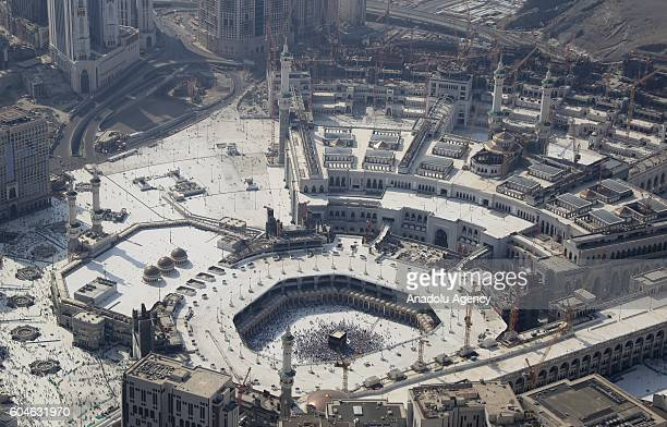 An aerial view photo shows that Muslim pilgrims circumambulate around the Kaaba Islam's holiest site located in the center of the Masjid alHaram...
