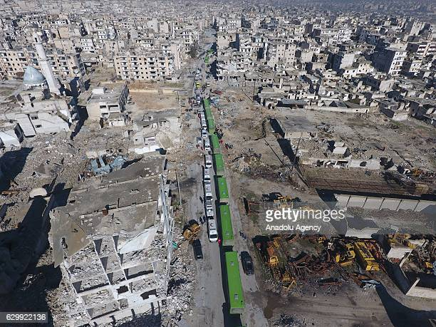 An aerial view show a convoy including busses and ambulances wait at a crossing point at Amiriyah District of Aleppo Syria on December 15 2016 to...