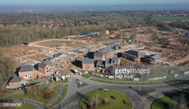 An aerial view shows a construction work at a building site for new homes and houses being built at a Barrat Developments residential property...