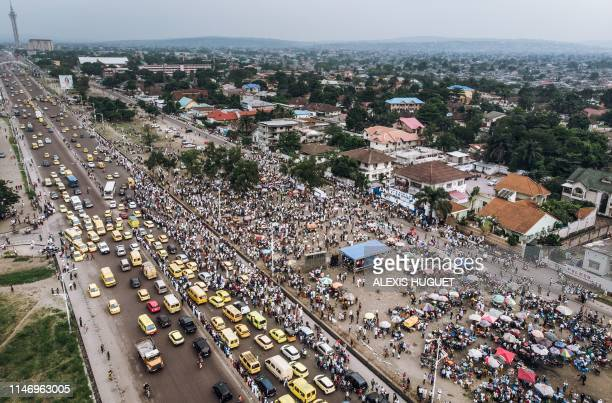 An aerial view shows a crowd gathered outside the Union for Democracy and Social Progress headquarters in the Limete neighbourhood of Kinshasa on May...
