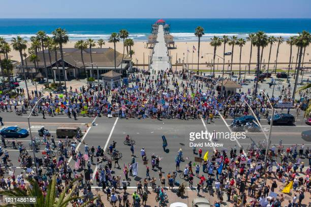 An aerial view shows a crowd of protesters calling to reopen businesses and beaches as the growing the coronavirus pandemic continues to cripple the...