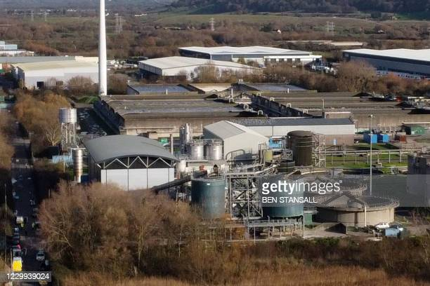 An aerial view shows a damaged silo at a waste water treatment plant in Avonmouth, near Bristol in south-west England on December 4, 2020 after an...