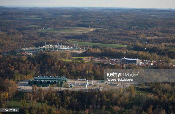 An aerial view shows a natural gas cryogenic processing plant and compressor stations under construction October 26, 2017 in Smith Township,...