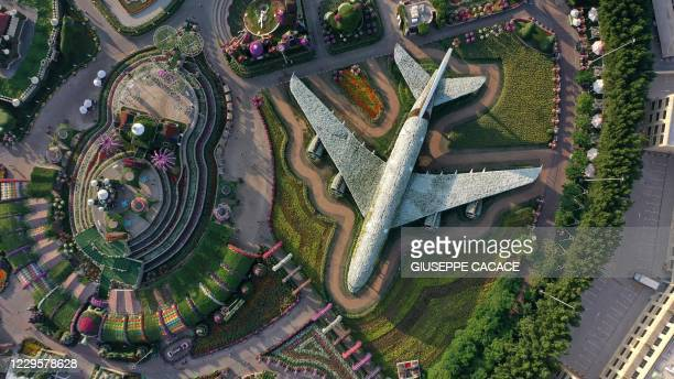 An aerial view shows a structure made of flowers of an Emirates Airlines Airbus A380 that made it to the Guinness Book of World Records, at the Dubai...