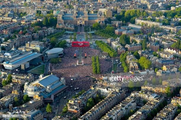 An aerial view shows Ajax fans gathering at Museum Square in central Amsterdam to watch the Europa League final football match between Ajax and...