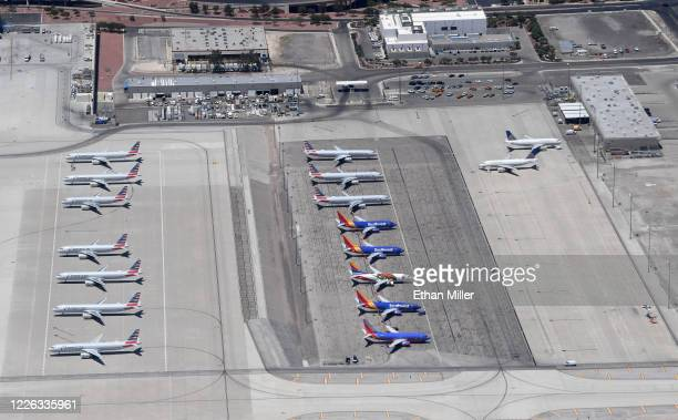 An aerial view shows American Airlines Southwest Airlines and United Airlines jets parked at McCarran International Airport amid the spread of the...