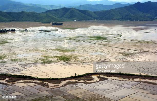 An aerial view shows an area affected by floods in Imphal in the northeastern Indian state of Manipur on July 15 2017 / AFP PHOTO /