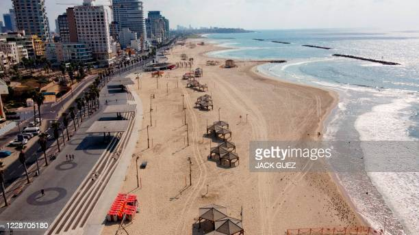 An aerial view shows an empty beach in the Israeli coastal city of Tel Aviv on September 25 after new coronavirus restrictions came into force to...