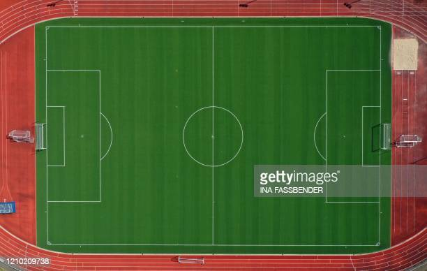 An aerial view shows an empty soccer field with artificial grass in Hagen, western Germany, on April 12 amid the novel coronavirus pandemic.
